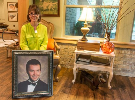 Debbie Autrey displays a portrait of her son, Will. Will died of drug overdose in 2014.