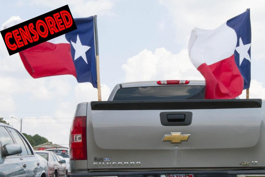 Texas flags fly in the beds of pickup trucks at Texas High School during the Texas vs. Arkansas game week. Some flags were vandalized with obsenities  the Wednesday before the game.