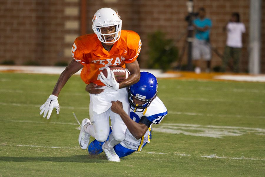 Junior Quan Hampton struggles to break free from a tackle. Tigers defeated the Wildcats 55-21 to open conference play.