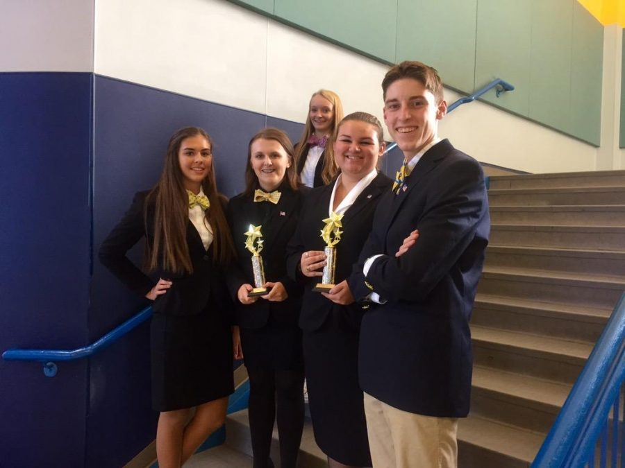 The debate team displays their awards after their competition on Sept. 19.