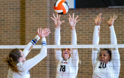 Freshman Kaitlyn Cross and senior Kristen McDuffie attempt to block a spike in the game against Sulphur Springs. The Lady Cats defeated the Lady Tigers 3-0.