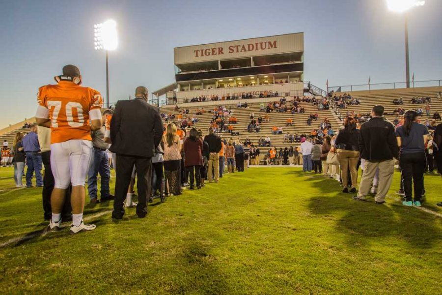 Texas High School seniors and their parents line up for the Senior Night presentation prior to the game against Greenville Thursday, Oct. 29, at Grim Stadium.