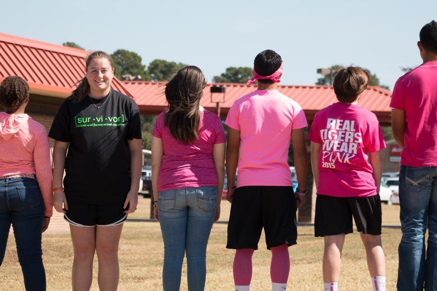 Senior+Kaylyn+Coleman+proudly+displays+her+green+shirt.+Coleman+wears+green+to+support+her+father%2C+who+is+a+lymphoma+survivor.