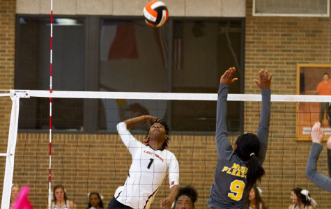 Junior Takeba Dowden returns the ball durning the volleyball game against Mt. Pleasant. The Lady Tigers won, 3-0.