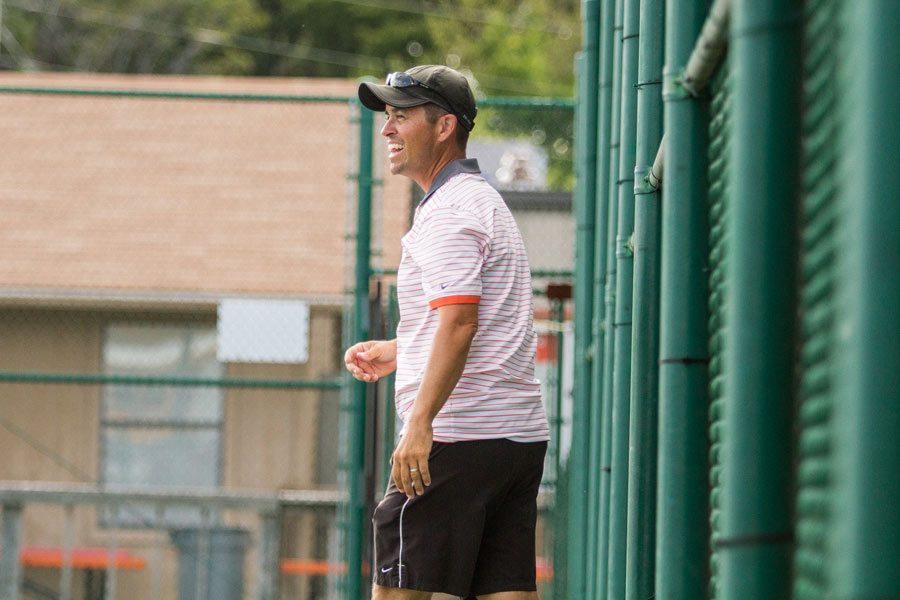 Tom Faulkner encourages the tennis team during practice.