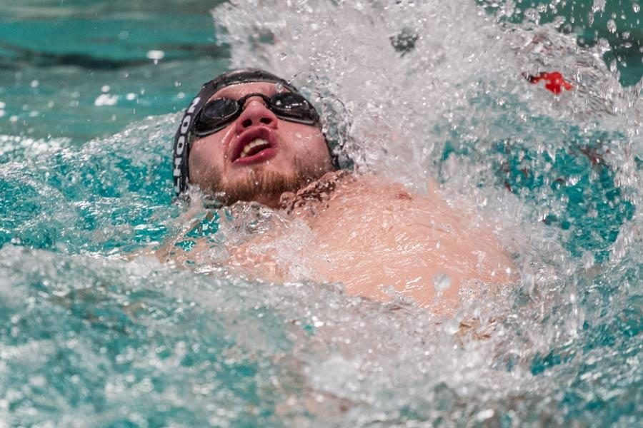 Texas High School's Luke Calhoon performs the backstroke Nov. 20, 2015 during the opening day of the TISCA meet held in the Pinkerton Center of Texarkana College.