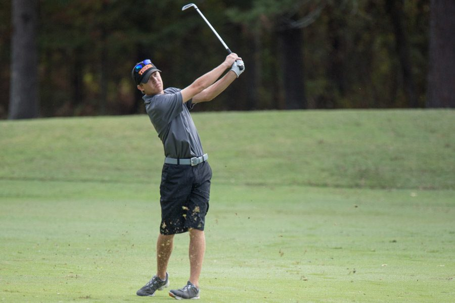 Matt+Prieskorn+swings+his+club+at+the+Tiger+Classic+golf+tournament.+Prieskorn+won+the+tournament+with+scores+of+70+and+75.