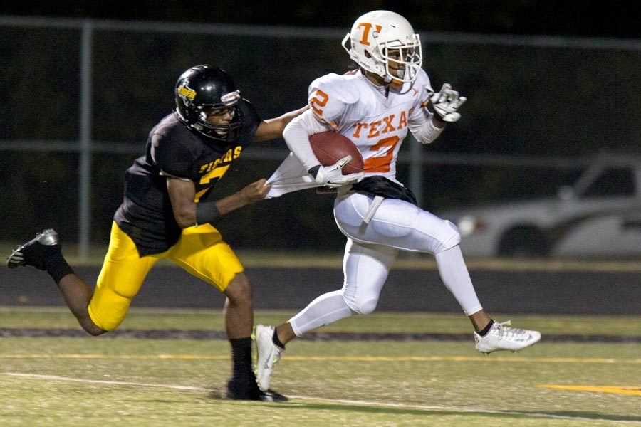 Texas Highs Quan Hampton pulls away from a Mt. Pleasant defender in the last district game of the season for the Tigers. Hampton scored a 43-yard touchdown in the fourth quarter against Mt. Pleasant.