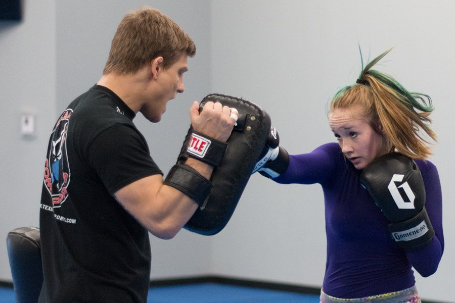Sophomore Michayla Hellums practices jiu jitsu with coach Craig Campbell