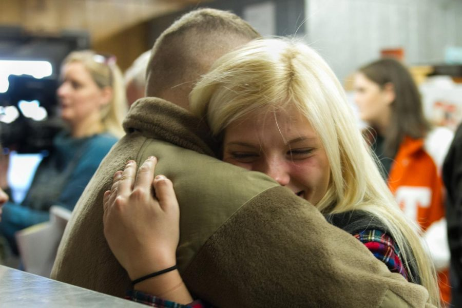 Junior Piper Spaulding hugs her brother Sawyer Spaulding. Sawyer surprised his two younger sister after serving in Afgahanistan and Italy for the last 22 months.