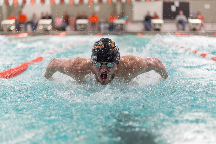 Senior+Luke+Calhoon+swims+the+200+yard+individual+medley+at+the+district+meet+on+Saturday.