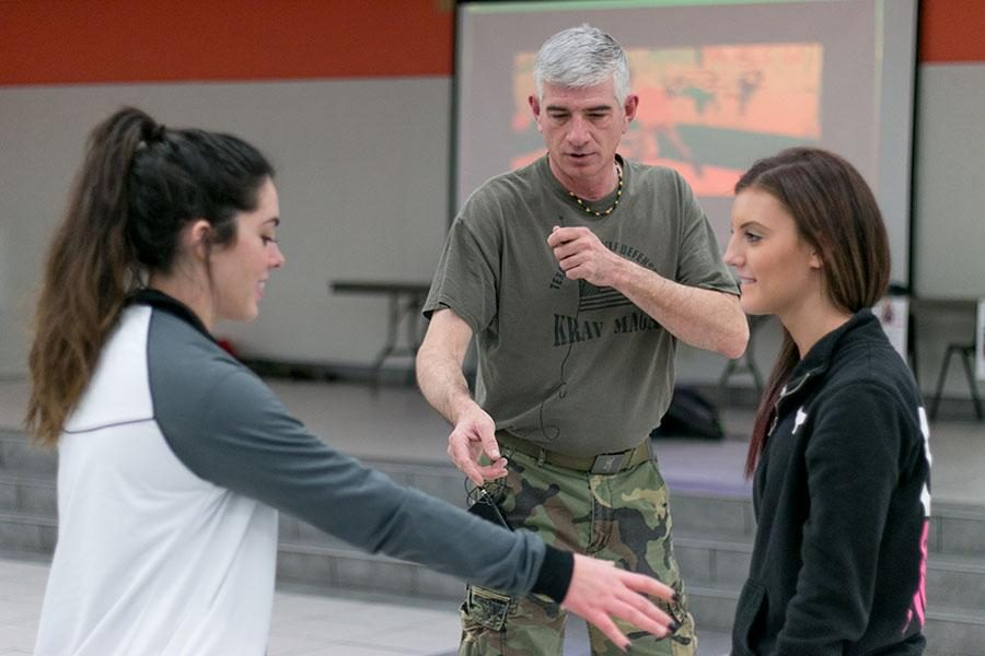 Seniors Julia Nations and Savanna Shively practice skills they learned in the Rosebuds self defense class on Jan. 14.