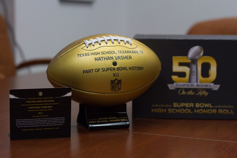 The golden football given in honor of alumni Nathan Vasher.