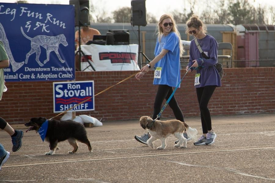Senior Abby Hill walks with her dog during the Six-Legged Fun Run and 5k held in downtown Texarkana