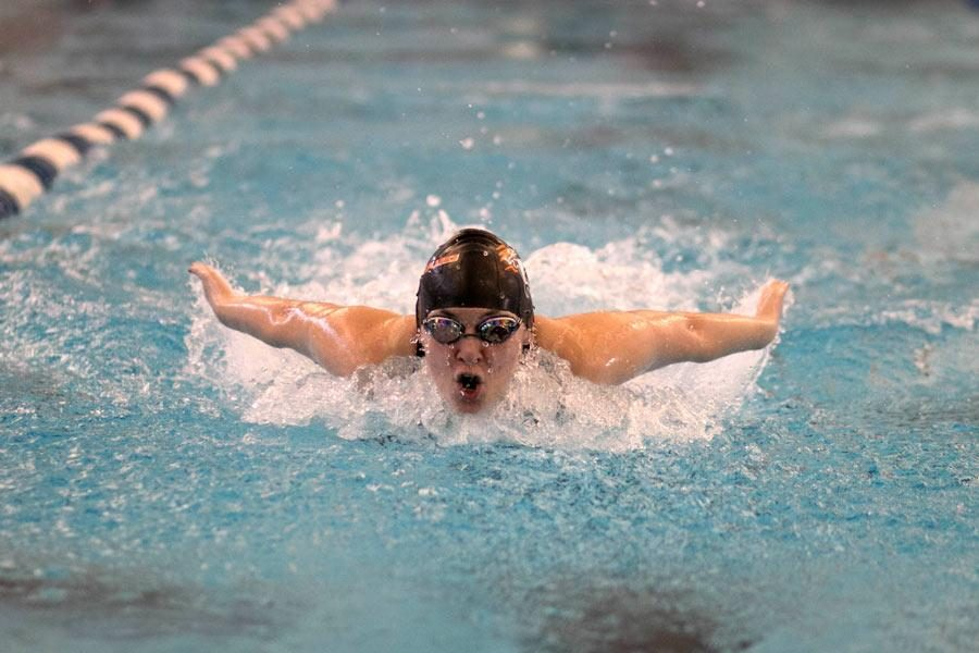 Junior Cathryn Payne swims butterfly in the 200 individual medley.