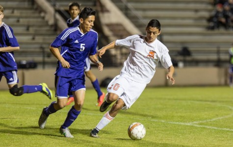 Senior Roger Moreno steals the ball from a Hallsville player. The Texas High boys varsity soccer team was defeated by Hallsville Bobcats.