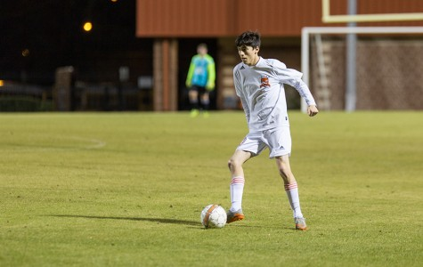 Senior Ethan Montez dribbles the ball up the field.