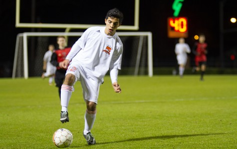 Junior Alejandro Hernandez handles the ball against Greenville.