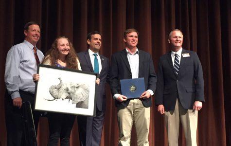 Superintendent Paul Norton, junior Rylie Power, senior Kip Williams, stand with U.S. Congressman John Ratcliffe, accepting Congressional awards.