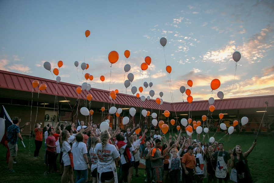 Seniors release balloons to mark the beginning of the new school year before the bacon fry at sunrise. The morning before the Texas vs. Arkansas game seniors gather to prepare breakfast for the student body.