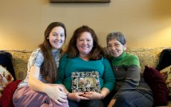Leah Crenshaw, Mary Kaye Crenshaw (mother) and Claire Taylor (grandmother) hold a picture of Leah's uncle. File photo.