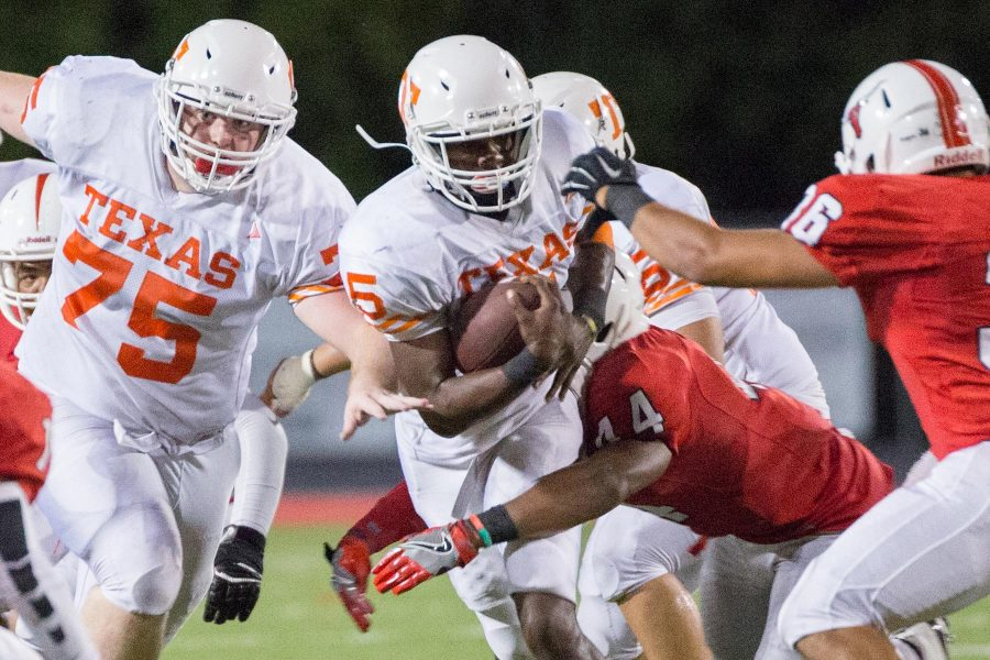 Texas Highs Devuntay Walker pushes his way through Marshalls defenders Friday night at Maverick Stadium. The Tigers defeated the Mavericks with a second half surge, making Texas High undefeated going into a bye week.