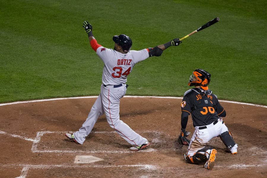 David Ortiz smashes a homerun against the Baltimore Orioles. photo by Keith Allison. Used with permission.