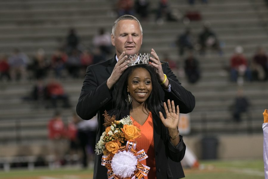 Principal Brad Bailey crowns Jasmine Grace Brooks as Homecoming queen.