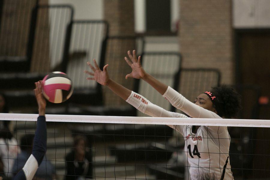 Sophomore Treyaunna Rush jumps to block the ball.