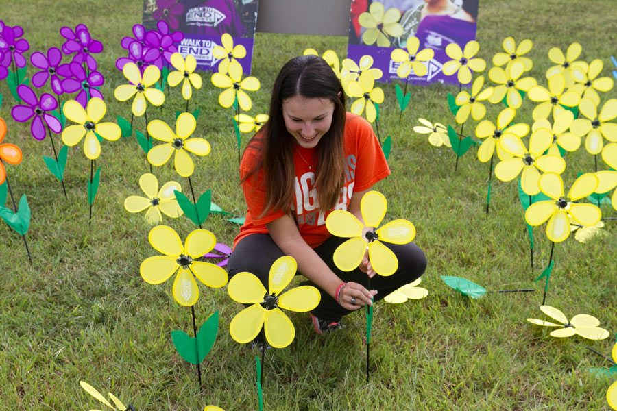 Senior Peyton Smith smiles as she helps set up for the Walk to End Alzheimers. This charity race took place at Texas A&M University-Texarkana on Saturday.