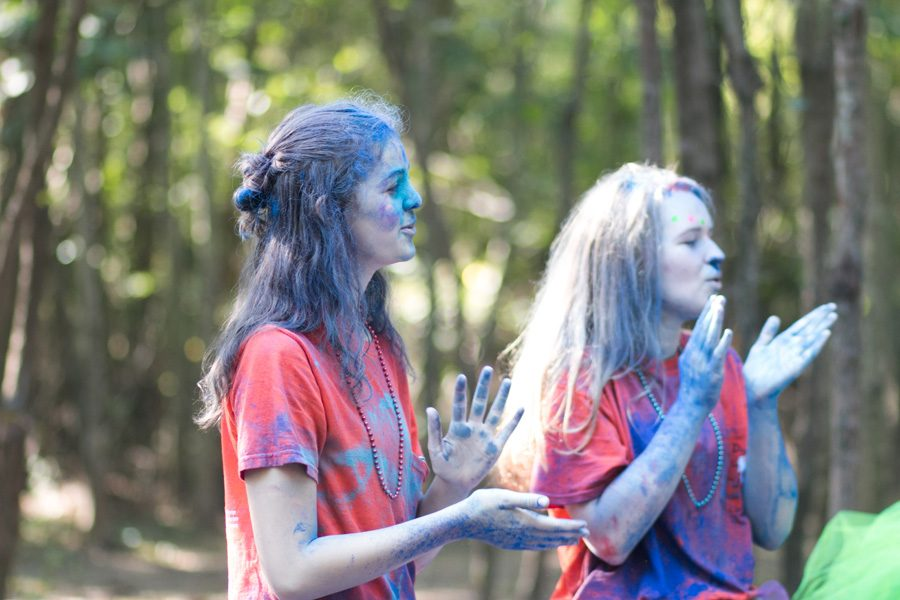 Juniors Ashley Wallace cheer on runners during the CASA Color Run. The Color Run was held at Trinity Church on September 24.