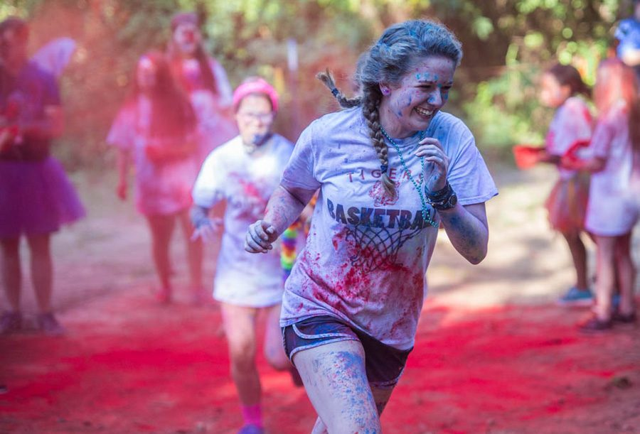Junior+Blair+Bledsoe+runs+the+trail+in+the+CASA+Color+Run.+The+Color+Run+was+held+at+Trinity+Church+on+September+24.+