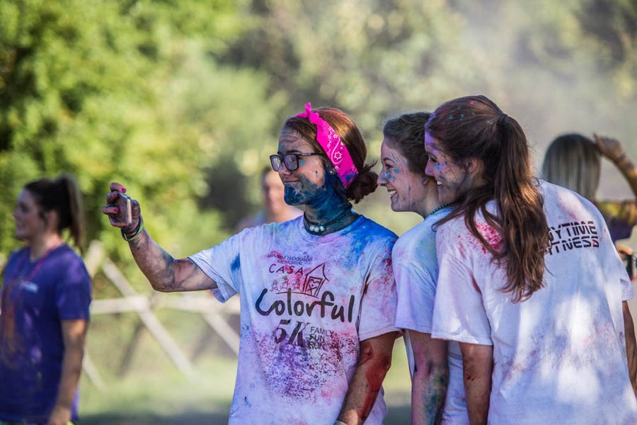 Junior Eleanor Schroeder, Blaire Bledsoe and Frances Schroeder take a selfie after the CASA Color Run. The Color Run was held at Trinity Church on September 24.