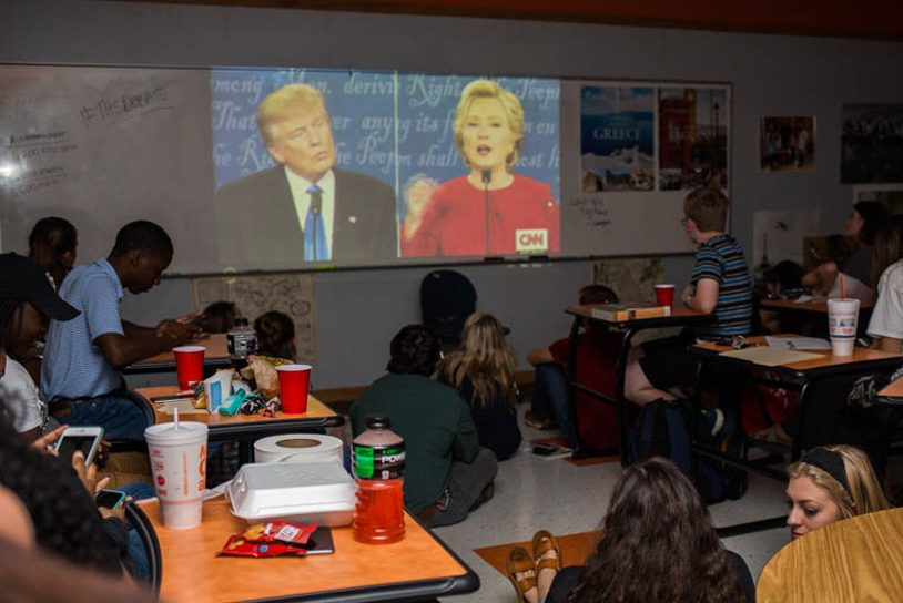 The Young Democrats (left) and Young Republicans (right) gather in Hunter Davis' classroom to watch the presidential debate. The debate was televised on Monday, Sept. 26.