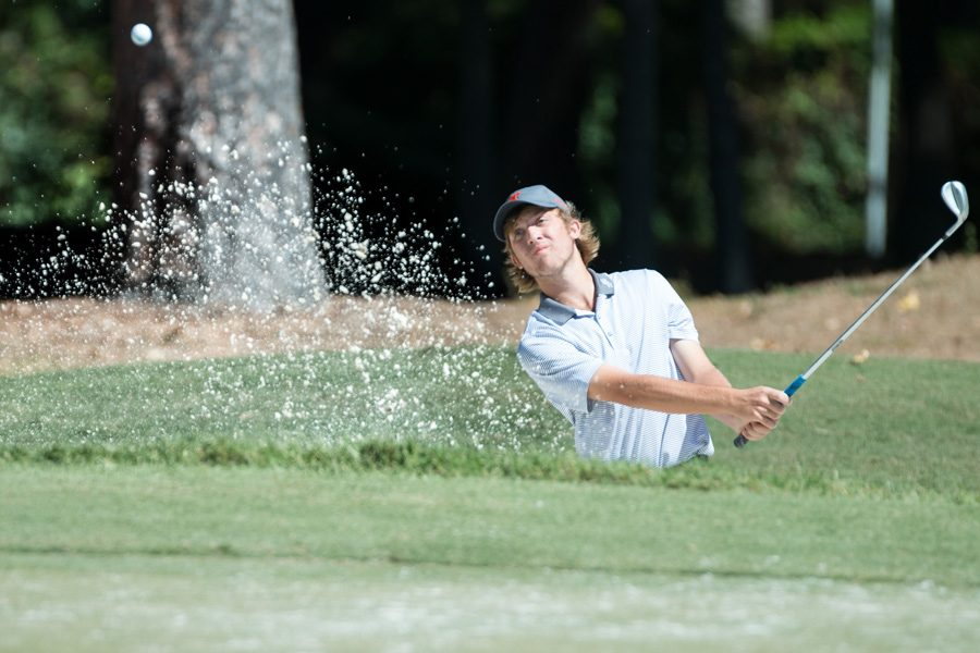 Junior+Matt+Prieskorn+chips+his+ball+out+of+a+sand+trap+during+the+Tiger+Classic+golf+tournament.+The+tournament+took+place+on+Sept.+30+and+Oct.+1.