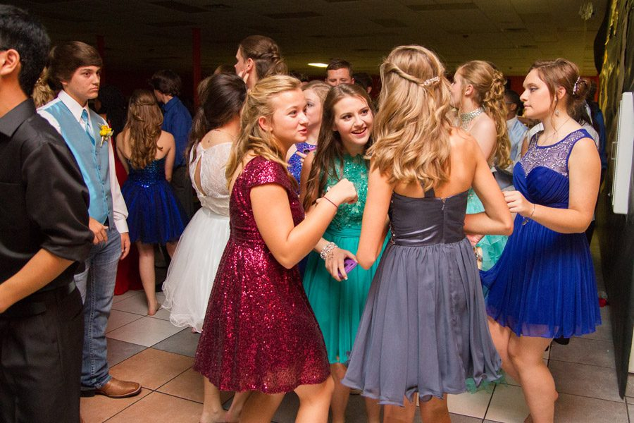 A group of students chat animatedly at last year's Homecoming dance.