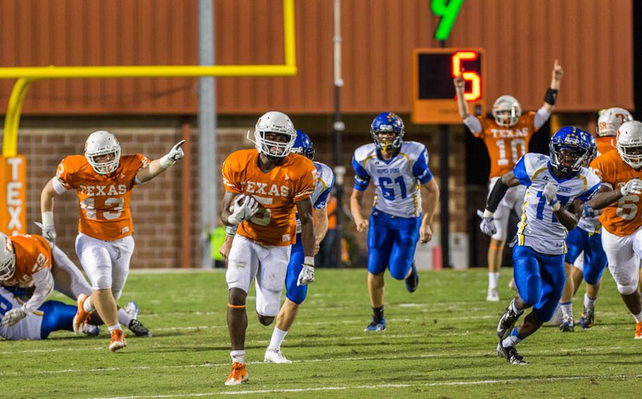 Senior Devuntay Walker rushes for a 69-yard touchdown in the third quarter against Sulphur Springs. Texas High improved their record to 6-0 with a win against the Wildcats.