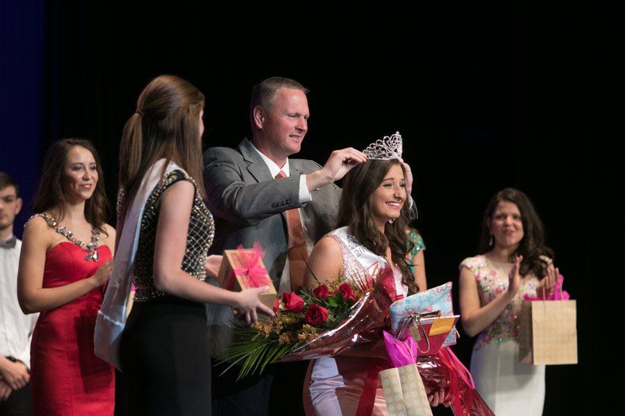 Principal Brad Bailey crowns Miss THS winner Madison Prince.