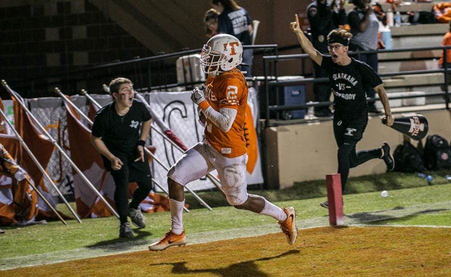 Cheer+escorts+Slyder+Welch+%28left%29+and+Tye+Shelton+%28right%29+celebrate+a+touchdown+by+Texas+Highs+Quan+Hampton.+Hampton+broke+a+single+season+reception+record+with+66+catches+for+the+2016+season.