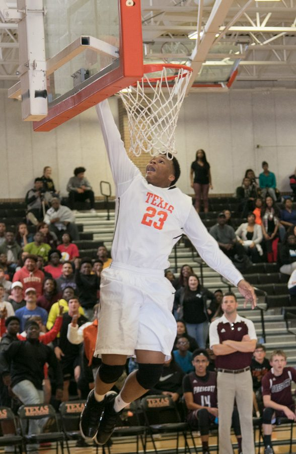 Senior Curtis Crump dunks the ball to score. District games for the girls and boys will begin in January 2017.