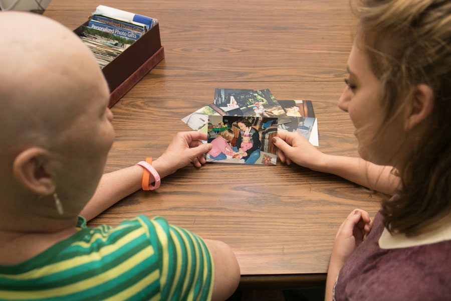 Tammy and Racheal Sizemore look at old pictures. Tammy was diagnosed with acute lymphoblastic leukemia in spring 2016 after previously recovering from breast cancer.