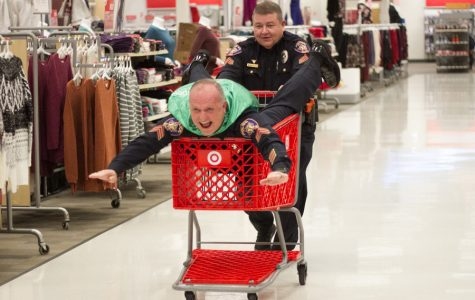 A couple of the police officers play around after the annual event of Shop With A Cop. This event took place December 6, 2017.