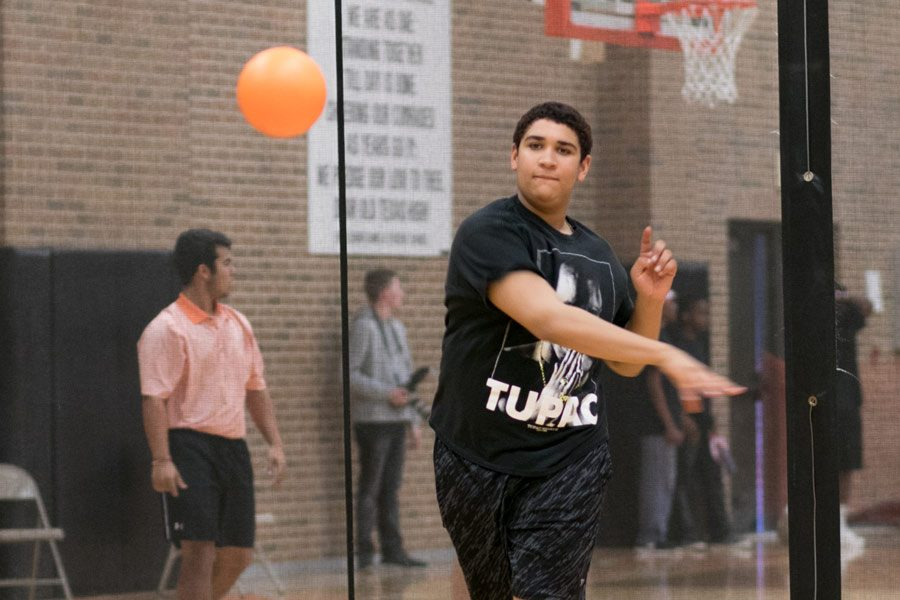 Junior Houston Hart throws a ball at an opposing team during the Dust Bowl Dodgeball Tournament. Harts team failed to advance to the final round of the tournament.