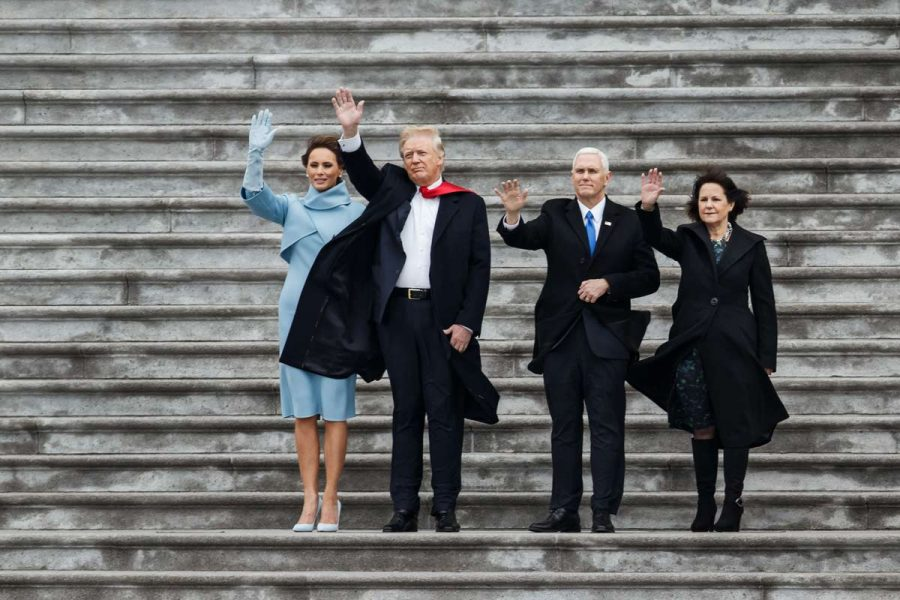 First Lady Melania Trump, from left, President Donald Trump, Vice President Mike Pence and Second Lady Karen Pence, wave goodbye to Executive One flying off carrying outgoing President Barack Obama and outgoing First Lady Michelle Obama after President Donald Trump's inauguration as the 45th President of The United States on Jan. 20, 2017 in Washington, D.C. (Marcus Yam/Los Angeles Times/TNS)