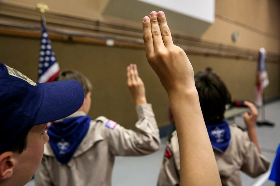Boy Scouts recite the Pledge of Allegiance at a church in Bothell, Washington. Many churches have ended their affiliation with the Boy Scouts because of their decision to allow LGBT members and leaders.
