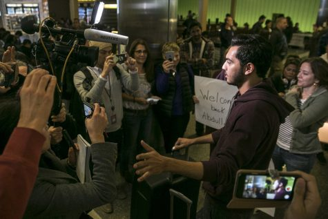 Abdullah Al Rifaie is interviewed by journalists after being greeted at Los Angeles International Airport by family a week after he was stuck outside the U.S. as part of the Trump administration travel ban. Photo by Robert Gauthier