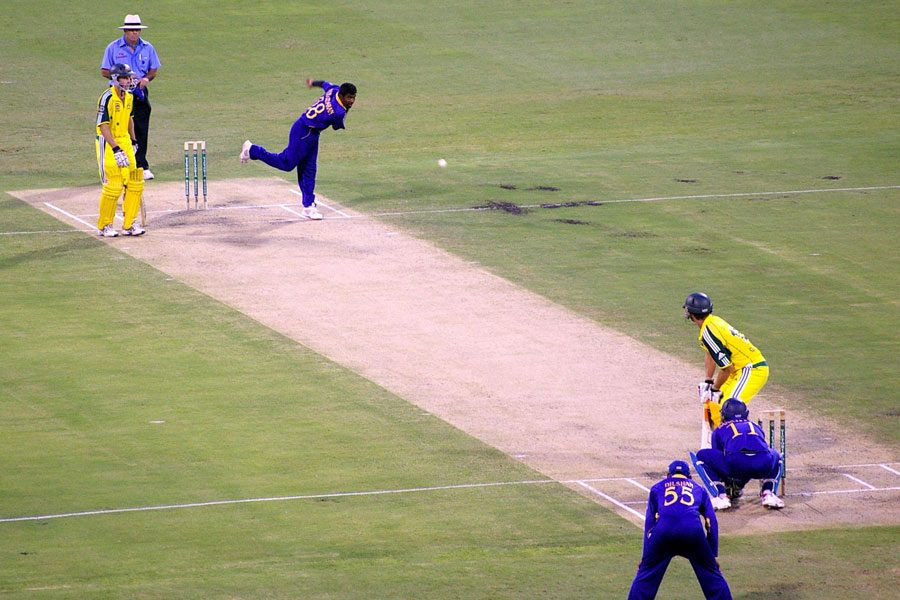 Muttiah Muralitharan bowls to Adam Gilchrist. Gilchrist went on to hit a centruy off 67 balls. Muralitharan finally bowled him for 122. Photo by Rae Allen