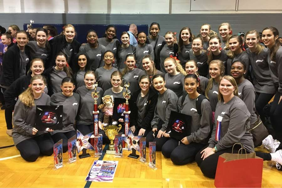 The Texas HighSteppers pose next to their numerous awards. Drill team competed in the American Dance/Drill Team Gussie Nell Davis Classic on Feb. 18. Submitted photo