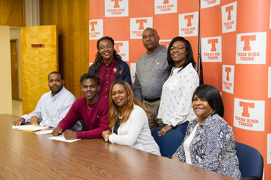 Senior Devuntay Walker is surrounded by family on National Signing Day. Walker committed to play for the Mustangs at Midwestern State University.