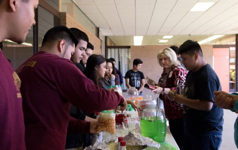 Members of Multicultural Club sell food during lunch. Funds go towards a trip for the club.